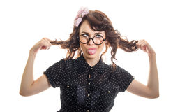 Expressive woman. Funny expressive woman sticking her tongue out and playing with her hair, isolated on white. Funny girl Stock Photography