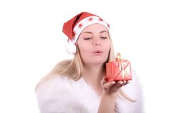 Expressive woman with gift in Santa hat Stock Image
