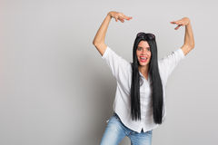 Expressive woman jumped on something Royalty Free Stock Photo