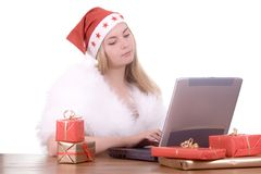 Expressive woman in Santa hat Stock Photos