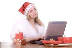 Expressive woman in Santa hat Stock Photos