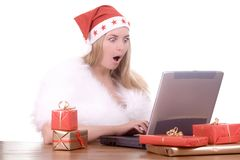Expressive woman in Santa hat Stock Photo