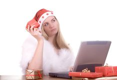 Expressive woman in Santa hat Stock Images