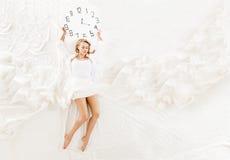 Expressive woman sleeping, dreaming concept Stock Photos