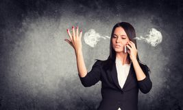 Expressive woman with steam from ears, talking on Stock Image