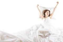 Expressive woman waking up Royalty Free Stock Photos