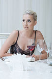 Expressive young blonde posing in restaurant Royalty Free Stock Photos