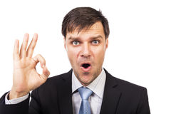 Expressive young businessman making  ok gesture Royalty Free Stock Photo