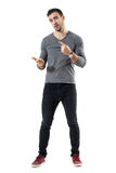 Expressive young casual man explaining and gesticulating with hands. Full body length portrait isolated over white studio background Stock Photography