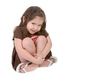 Expressive Young Child Hugging Her Legs stock images