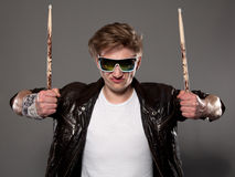 Expressive young drummer Stock Photo
