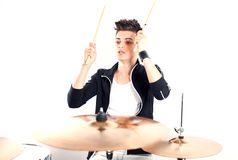 Expressive young drummer playing at the drums with drum stick Stock Photos