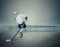 Expressive young hockey player on ice Stock Photography