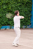 Expressive young man playing tennis Stock Photography