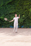 Expressive young man playing tennis Royalty Free Stock Images