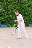Expressive young man playing tennis Stock Photo