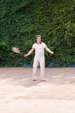 Expressive young man playing tennis Royalty Free Stock Image