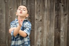 Expressive Young Mixed Race Boy Making Hand Gestures Stock Image