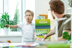 Expressive young nature lover being interested in garbage polluting. Poster about recycling. Expressive young nature lover being interested in garbage polluting royalty free stock photography