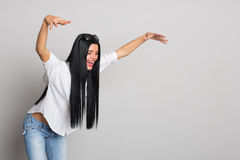 Expressive young woman jumped on something Stock Photos