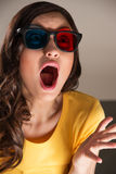 Expressive young woman watching 3d film Royalty Free Stock Photography