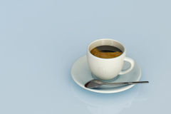Expresso. Cup  over a light blue background Royalty Free Stock Photography