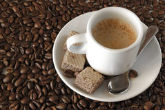 Expresso Coffee. With cookies over roasted coffee beans Royalty Free Stock Photos