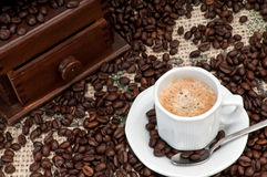 Expresso Coffee and beans. Cup of Expresso Coffee with old grinder and coffee beans stock images