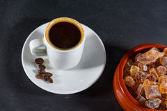 Expresso coffee with beans by German rock sugar Brauner Kandis i Stock Photos