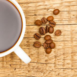 Expresso and coffee beans on old wooden table Stock Images