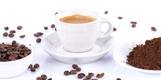 Expresso with coffee beans and powder Stock Image
