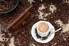 Expresso Coffee Cup. Cup of Expresso Coffee with old grinder and coffee beans royalty free stock image