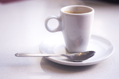 Expresso coffee cup. And saucer in Italian restaurant cafe royalty free stock image