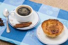 Expresso coffee and egg custard pastry. Typical Portuguese breakfast with expresso coffee and egg custard pastry stock photos