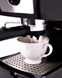 Expresso coffee machine. And a coffee cup royalty free stock photography