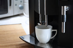 Expresso coffee machine. With a coffee cup stock images