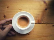 Expresso. A cup of expresso coffee on wooden table stock photos