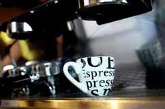 Expresso cup. Getting coffee mug coffee maker Royalty Free Stock Photography