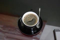 Expresso de café sur le fond en bois de plancher Photographie stock libre de droits