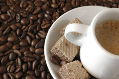 Expresso Detail. Expresso coffee with cookies over roasted coffee beans Stock Photos
