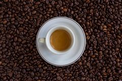 Expresso Over Coffee Beans. Hot expresso over coffee beans stock image