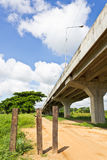 Expressway. Non-Asphalt Road Under Bypass Road Leading to the City Royalty Free Stock Image