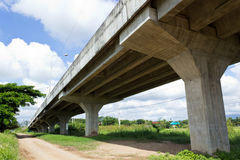 Expressway. Non-Asphalt Road Under Bypass Road Leading to the City Stock Photo
