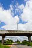 Expressway. Asphalt Road Under Bypass Road Leading to the City Royalty Free Stock Photography
