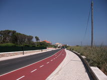 The expressway on the coast of Cascais on a sunny afternoon (Portugal). Picture of Cascais on a sunny afternoon (Portugal Stock Photos