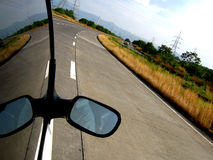 Expressway Curve. A car travelling on an expressway with a curve ahead Royalty Free Stock Images