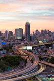 Expressway intersection with city downtown Stock Photo