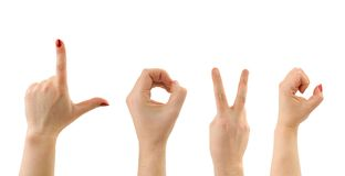 Exprima o amor feito das mãos do homem e da mulher Imagens de Stock