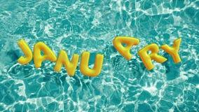 Exprima o anel inflável dado forma ` da nadada de JANEIRO do ` que flutua em uma piscina azul de refrescamento Foto de Stock