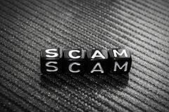 Exprima Scam de cubos pretos em um cinza foto de stock royalty free